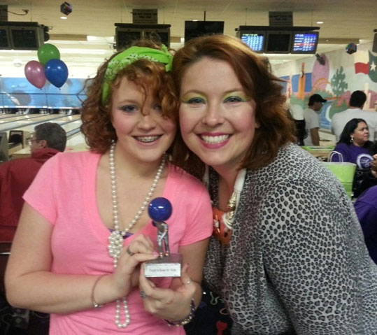 Sam and CJ at Trudy's Bowl for Kids 2013. (It was an '80s theme!)