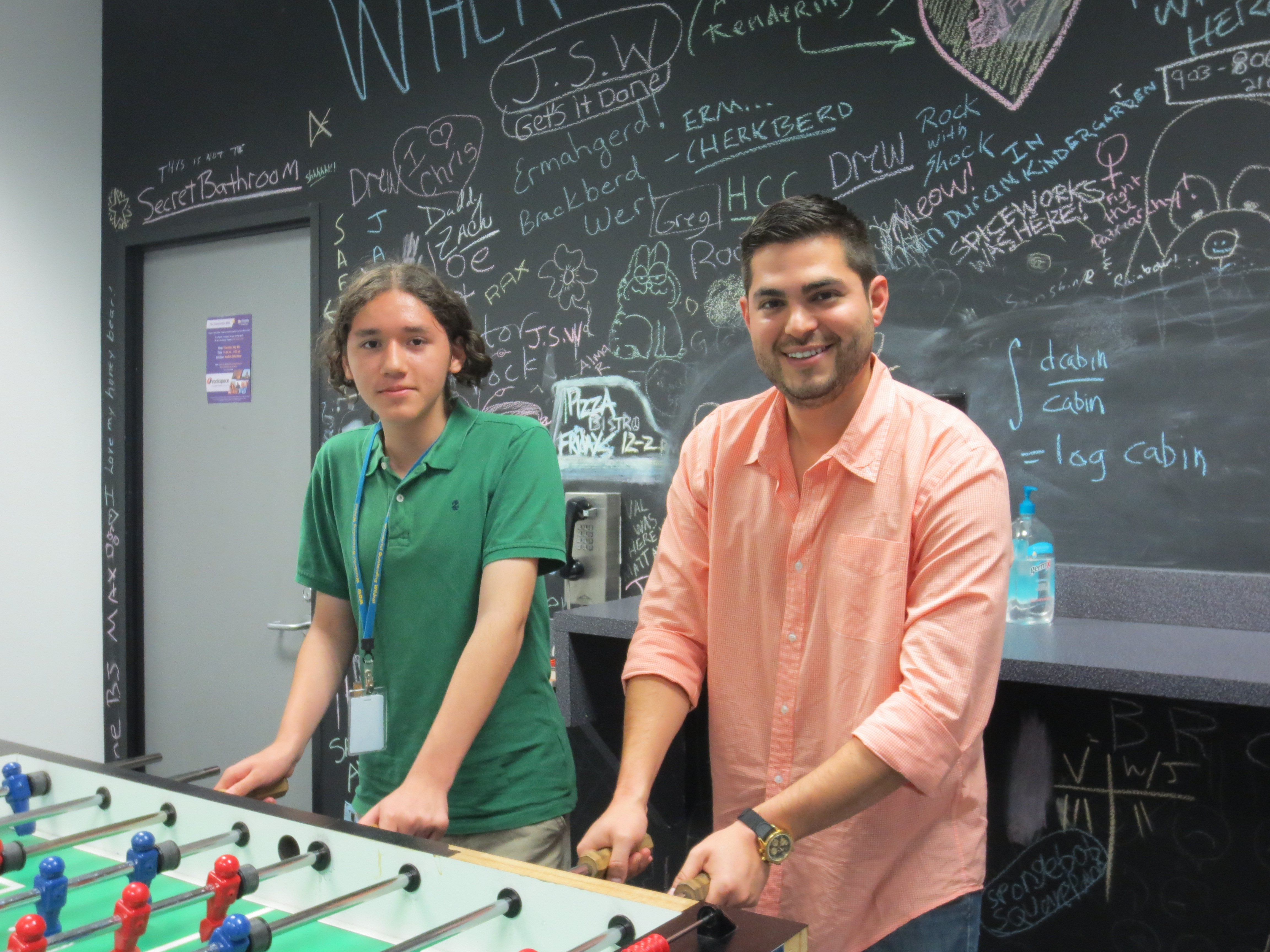Little Brother and Big Brother enjoying some foosball in the Rackspace game room!